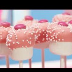 Marshmallows dipped in with chocolate (with pink food coloring) with sprinkles and an M!
