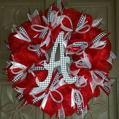"""This is a Alabama Crimson Tide deco mesh 24"""" wreath made with red and white mesh and accented in houndstooth ribbons and a houndstooth script A.  ALL custom wr"""