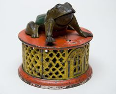 Made in many color combinations and designed by Russell Frisbie, the Frog on Round Base mechanical bank was patented on August 20, 1872 and manufactured by J. & E. StevensCompany.