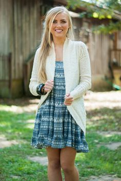 """Wrap this wavy cardigan around yourself to add that coveted boho feel to any dress or outfit! The color goes with anything and the thin, open construction adds no bulk!   Bra-friendly! Material has fair amount of stretch.  Lauren L. is wearing the size small.   Length from shoulder to hem: S- 28.5""""; M- 29.5""""; L- 30.5""""."""