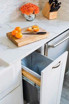 En sån ska vi ha! Trash can drawer and Dekton countertop in newly remodeled kitchen