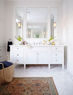 Go beyond the typical bath mat and elevate your bathroom with a stylish rug underfoot.