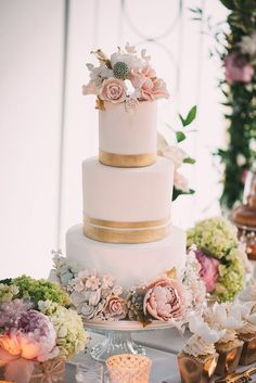 Featured Photographer: Julius and James Photography, Via Rebecca Chan Weddings & Events; Elegant gold wrapped blush flower wedding cake