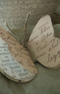 idémakeriet: Pyssla fram våren: butterflies of reused book pages & twine.idémakeriet: Craft until spring - paper butterfly made from old books.Paper Butterfly no instructions but looks like 3 butterfly shapes tied with string HThese would be sweet Paper Butterflies, Beautiful Butterflies, Paper Flowers, Diy Flowers, Flowers Garden, Beautiful Flowers, Diy Paper, Paper Crafting, Paper Art