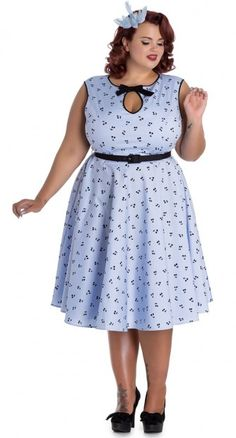 The Martina Dress is super light and sweet! Made out of a pretty blue cotton, it has an all over pattern of black cherries.