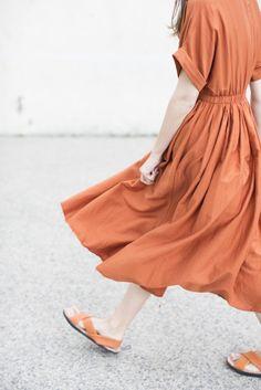 Black Crane Pleated Dress in Brick | Oroboro Store | Brooklyn, New York
