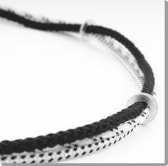 Handmade bracelet with 3 thin nautical black and white ropes and seven steel rings. Can be worn also as a necklace. Measurements: medium: 66cm, large: 68cm, extra large: 70cm