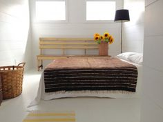 Paula Greif's bedroom over her Hudson, NY, ceramics shop | Remodelista