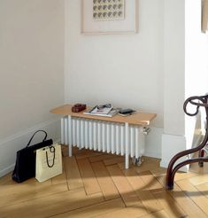 In the entryway Zehnder, radiator Charleston Relax  - See more at: http://magazine.designbest.com/en/inspiration/trend/a-radiator-for-every-room/10-radiatori/#image1