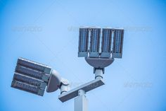 LED street lamps post on white background ...  air, atmosphere, avenue, background, big, boulevard, bright, brighten, electric, electricity, energy, equipment, fixture, guide, halogen, high, idea, illuminate, illumination, isolated, lamp, lamppost, led, light, lighten, mercury, message, monument, new, object, outdoor, outside, pole, post, road, saving, shine, sidewalk, sky, slogan, steel, street, sunny, sunshine, technology, up, utility, walkway, white, xenon