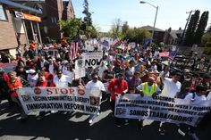 Demonstrators march down 20th Ave S for the 13th Annual May Day March for Workers and Immigrant Rights. In the spirit of unity and solidarity with communities across the country, organizers in Seattle will focus on a universal theme: standing together with all workers regardless of race, class, gender. (Photo by Steve Ringman / The Seattle Times)