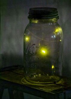 Catching fireflies and putting them in a glass jar - part of my childhood!  We always put holes in the lids, and let the fireflies go before we went inside for the night!