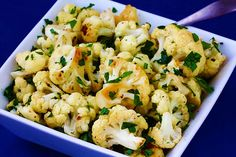 "Garlic-Roasted Cauliflower  ""an entire head of roasted garlic, parsley, lemon juice and pine nuts. Roasting the cauliflower and adding freshly grated Parmesan really enhance the recipe."