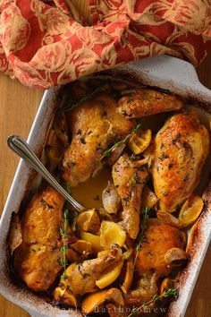"Slow Roasted Chicken with Lemon and Garlic - ""gloriously easy"" •1 chicken cut into 10 pieces   •2 heads of garlic, separated into unpeeled cloves   •2  lemons, cut into 8 pieces each   •Fresh thyme, large handful   •3 tablespoons olive oil   •6 oz. white wine   •Black pepper"