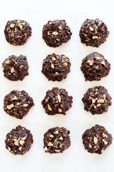Vegan and Gluten Free No-Bake Dark Chocolate Almond Cookie Recipe on twopeasandtheirpod.com These easy no-bake cookies are rich, fudgy, and the perfect summer treat!