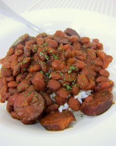 Slow Cooker Red Beans & Rice - red beans and andouille sausage served over rice - SO good! No need to soak the beans - just dump in the slow cooker with everything else