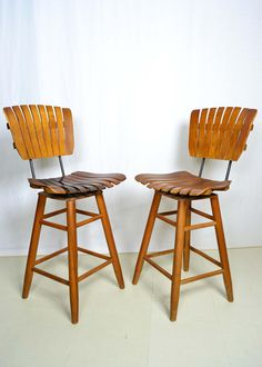 Pair of 1950s Mid Century Modern Wood Slat Swivel Chairs Barstools in Manner of Arthur Umanoff by OffCenterModern on Etsy