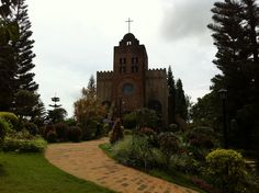Family weekends aint complete without a side trip to Caleruega Church in Tagaytay, Philippines. Tagaytay Philippines, Family Weekend, Notre Dame, Places Ive Been, Spaces, Building, Travel, Viajes, Buildings