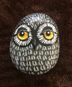 Owl painted on a rock by Linda Hallett.