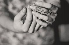 Notes on the Finger Tattoo or the Treble Clef & Bass Clef together to form a heart.