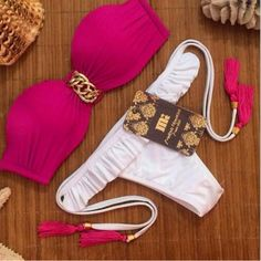 Look stylishly sexy and comfortable in this lovely two piece swimwear. This two piece set features a strapless top with lovely designs and a low waist sexy bottom with ruffles and self tie fringe stra