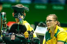 Michel, who was born with spinal muscular atrophy - a severe disability that affects his ability to move his arms, legs and torso, made his Paralympic debut on Wednesday at Carioca Arena alongside his sporting assistant, Ashlee McClure (right)