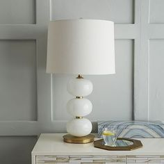 I want this as a bedside lamp!  But $199 won't fit my budget..need to find another similar option...Abacus Table Lamp - Milk White #westelm