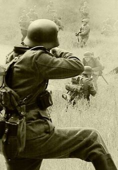 Nazi soldiers firing at/in battle with what looks like Soviets. Incredible photo wow.....