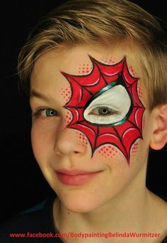 Simple and effective face painting idea for spiderman face art.