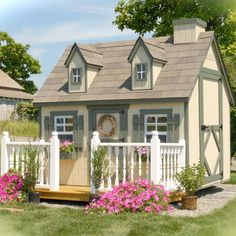 Cape Cod-style playhouse kit. Ready to assemble.   Product: PlayhouseConstruction Material: Wood and glass