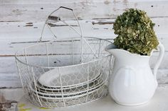 Wire egg basket, ironstone plates and pitcher.