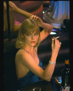 Michelle Pfeiffer as Elvira Hancock in Scarface Elvira Hancock, Elvira Scarface, Scarface Movie, Michelle Pfeiffer Scarface, Women Smoking, People Smoking, Girl Smoking, Brian Atwood, Style Icons