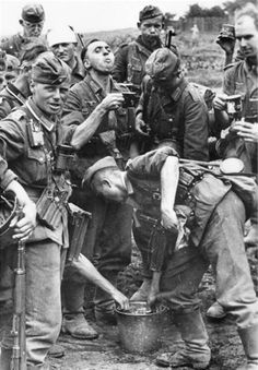 German soldiers and officers drink water from a bucket. Heat. The road to Stalingrad.  August. 1942