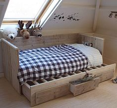 Toddler bed, with trundle and drawers in the trundle.