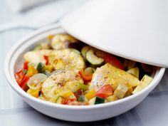 A simple Fish and ratatouille tagine recipe for you to cook a great meal for family or friends. Buy the ingredients for our Fish and ratatouille tagine recipe from Tesco today. Ratatouille, Couscous, Fish Tagine, Surimi Recipes, Gourmet Recipes, Healthy Recipes, Healthy Food, Jucing Recipes, Coctails Recipes