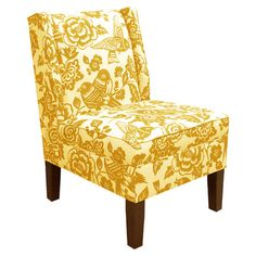 Floral+and+bird-upholstered+accent+chair+in+canary+yellow+with+a+low-profile+wingback,+pine+wood+frame,+and+foam+padding.+Handmade+in+the+USA.