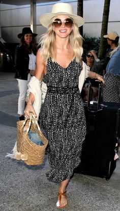 Julianne Hough in a black and white pattern maxi dress and beach hat