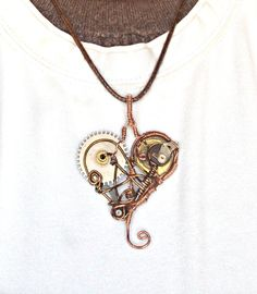 Mechanical heart steampunk pendant.    This pendant is made with non tarnish copper wire, wrapped in a hear shaped design, incorporating cogs and