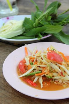 Som Tam Thai (ส้มตำไทย)Som tam ' spicy papaya salad ' comes from northeast Thailand, but it's reached near-cult status throughout the rest of the country.