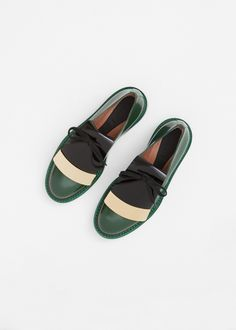 "Leather derby in green with an rounded toe. 1.7"" heel in stacked green wood and sole in black leather. Hidden lace-up closure under detachable, oversized tongue in black with gold metallic bar detail. Leather insole. Dust bags included."