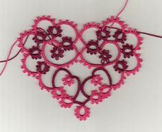 Stitching 'n' Knitting: Making Little Hearts for Valentines DayThe pattern can be found here and Frivole of Le Blog de Frivole has made a chart to go with it which can be found here.  This is one of the first pieces of tatting I've ever been able to scan and it shows up so much better in a scan than in a photo.