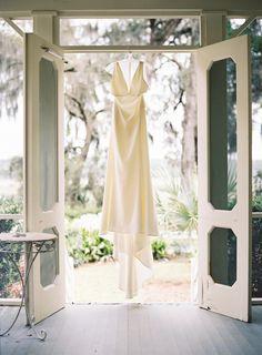 Elegant chic Amsale wedding dress: http://www.stylemepretty.com/2016/11/17/intimate-south-carolina-waterfront-wedding/ Photography: Graham Terhune - http://grahamterhune.com/