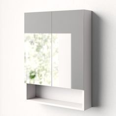 The medicine cabinet increases storage space and has a decorative open shelf on the bottom.