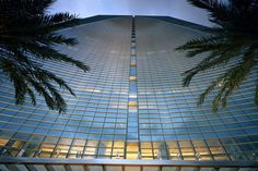 With simple, elegant lines and a sculptural form, this iconic mixed-use building is home to the Espirito Santo Bank headquarters, the Conrad Hotel and luxury. Luz Natural, Conrad Hotel, Condo Interior, Magic City, Facade Design, South Florida, Miami Florida, At The Hotel, Amazing Architecture
