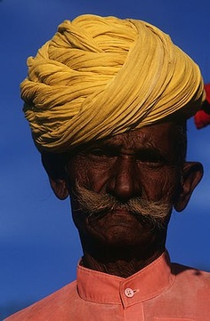 Village man in traditional Rajasthani colourful clothing in Mount Abu