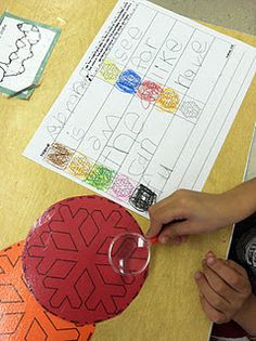sight words typed really small. Kids have to find with magnifying glass.