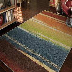 Our Vibrance Magnificent Multi area rug is filled with vibrant colors in an array of exciting shades and tones. This rug has a beautiful contemporary design that will showcase like a dramatic piece of artwork for the focal point in any room.