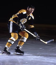 March 1969 - Boston Bruins center Phil Esposito became the first NHL player to score 100 or more points in a season when he slapped in two goals in Bostons victory over the Pittsburgh Penguins at Boston Garden. He finished the season with 126 points. Boston Bruins Hockey, Pittsburgh Penguins Hockey, Chicago Blackhawks, Phil Esposito, Hockey Pictures, Bobby Orr, Boston Sports, Vancouver Canucks, Sports Figures