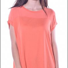 Cap Sleeve Tunic Swingy cap sleeve tunic with crepe bodice. Material Content: 95% Viscose/ 5% Spandex. Made in the USA. Pastels Tops Tunics