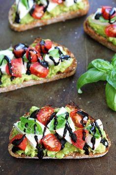 Caprese Avocado Toast Recipe on http://twopeasandtheirpod.com Caprese salad meets avocado toast!